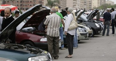Customers examine car engines in a second-hand lot at the biggest open-air dealership in Cairo