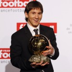 Messi holds the 2009 Ballon d'Or trophy in Paris